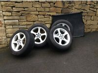 Set of 4 BMW wheels & winter tyres plus boot protector mat