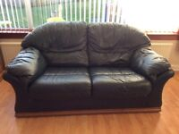 Two seater leather settee and foot stool