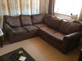 Large brown corner sofa (worn)