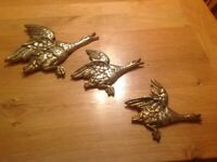 Set of three solid brass Flying Geese.