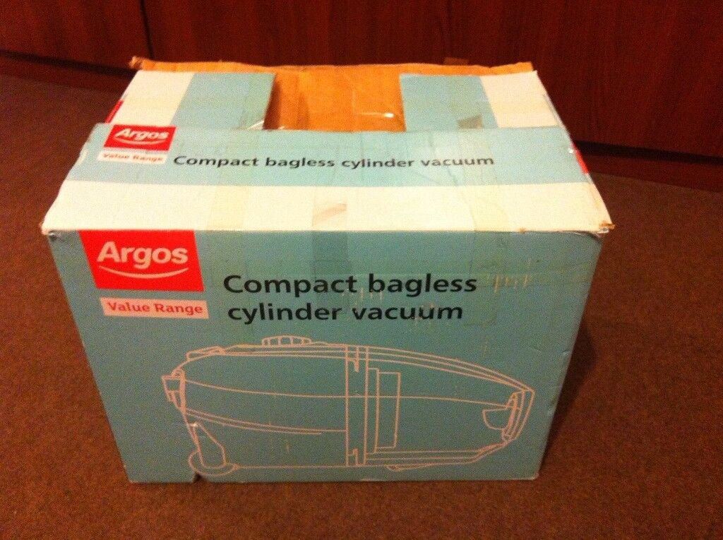Compact bagless cylincer vacuum