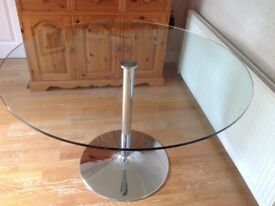 Modern round glass table with chrome pedestal. Easily seats 4, 120cm wide & 75cm high.