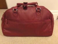 Red leather weekend bag/travel baglo