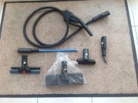 Various accessories for use with the Polti Vaporetto 2400 steam cleaner