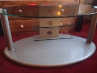 """Tv Stand, large 3 tier glass/silver OVAL 45"""" to 60"""