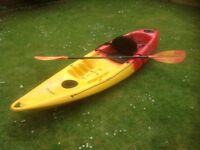 Feel free sit on kayak in yellow and red. Minor scratches on the bottom with trolley and paddle