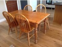 solid wood table and 4 wooden chairs