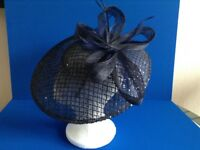 A navy beautiful fascinator hat suitable for Wedding or Ascot worn once excellent condition