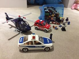 Playmobil emergency services vehicles plus a box of people and accessories