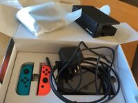 Nintendo Switch for sale with Super Mario Kart 8 Deluxe, still in box, barely used, unwanted gift