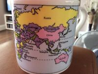 A Drinking Mug with a map of the World.