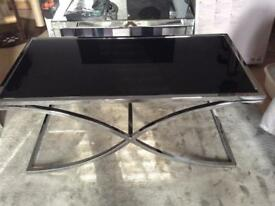 Italian coffee table. Chrome and black glass top.