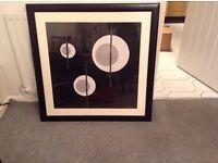 Large black framed picture