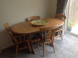 Extending pine dining table and 6 chairs