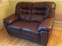Brown leather sofa.