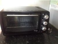 Mini oven roasts bakes ideal for small kitchen or caravan