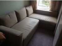 By day, a corner sofa, by night a double bed! With built in storage.