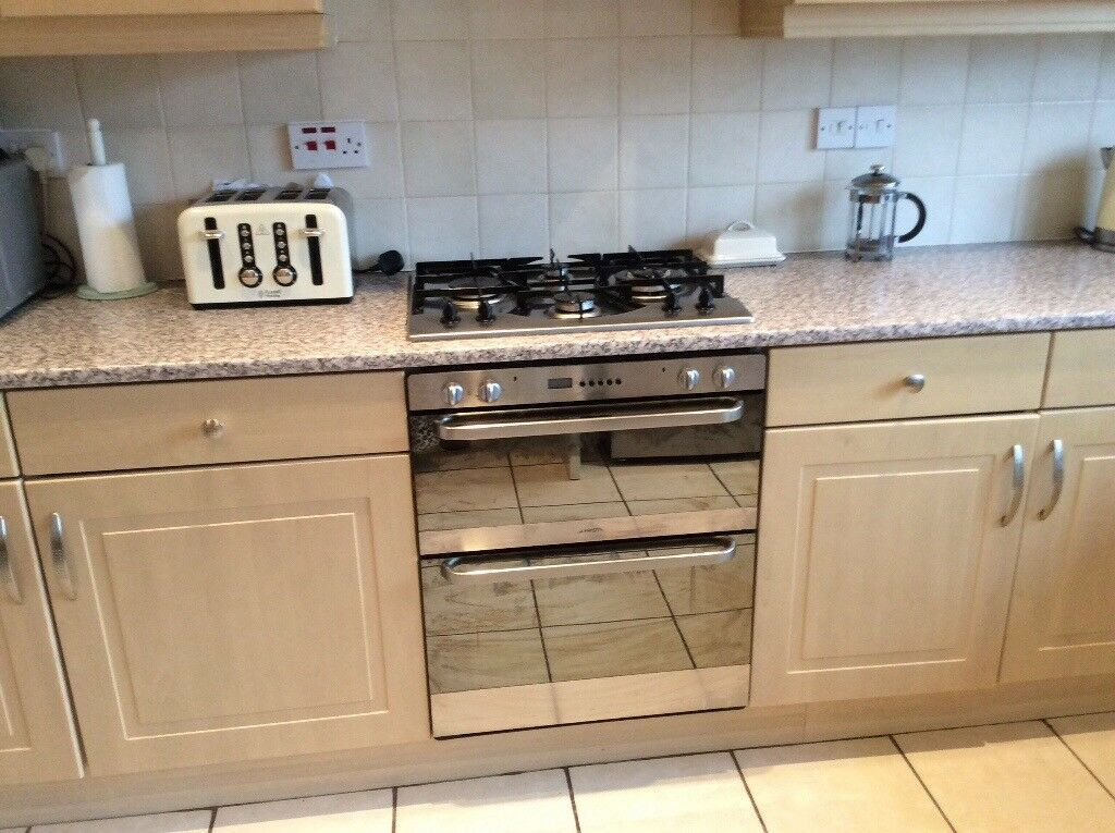 Kitchen including double oven, gas hob, sink and benches