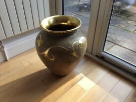 Large ornamental terracotta urn in gold/ beige colour