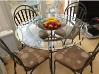 Quality shaped glass dining table & mocha upholstered dining chairs - OPEN TO OFFERS!!!