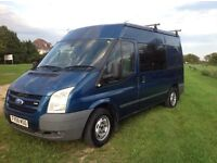 Ford Transit Van/Camper, medium size, five seater with double bed.