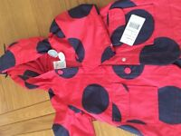 New wth labels rain jacket age 2