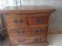 Mexican style hard wood chest of draws and two bedside tables
