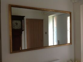Large mirror in antique gold frame.