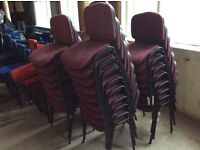 Ten Maroon material Stacking Chairs