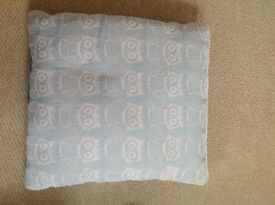Four duck egg blue accent sofa cushions it's owl embroidery. Excellent condition.