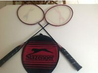 Two badminton rackets
