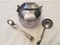 Vintage glass sugar cube grabber, sugar sifter spoon and sugar tongs.