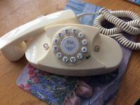 Press Butto cream telephone. Called Princess.