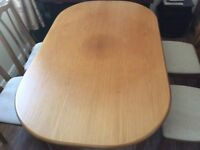 Dining table and 6 matching chairs. Good condition