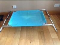 Raised dog bed (large) up to 45kilo. We bought for our German Shepherd but feel it's just to neat.