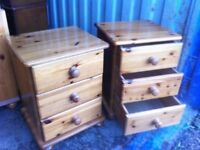 Matching pair of solid pine three drawer bedside units