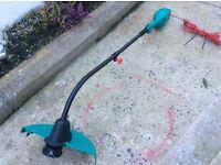 New unused unwanted gift Bosch Art35 longreach grass strimmer 600 watt 35cm ergonomic. Light weight