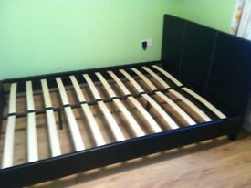 Double bed and mattress.black leather like New,used five times. Richhill. 125£