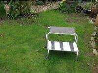 Metal double steps suitable for caravan or motor home. Folds for easy storage
