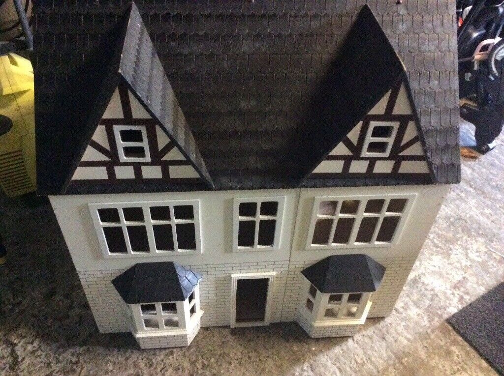 Dolls house complete with some furnitue