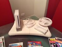 Wii console, accessories plus games
