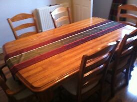 Dining suite, Table 6 chairs and display cabinet £250 ONO will separate