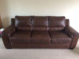Three seater brown leather sofa and armchair