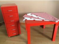 Red Ikea 6 drawer filing cabinet, high gloss table and floor cushion covers