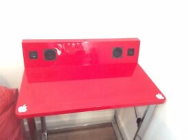 Red desk with speakers