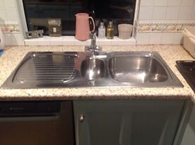 Kitchen sink. Stainless steel 1 and 1/2 bowls