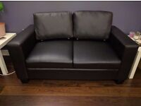 NEED GONE ASAP Black faux leather sofa 2 weeks old 2 seater