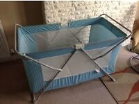 Travel cot, solid enough to use all the time, large enough to make a good play pen.