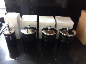 Heavy glass , cut glass black & chrome canisters