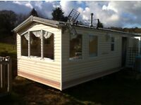 BK Bluebird Lymington 2004 28x10 two bedroom privately owned static caravan in St Austell for sale
